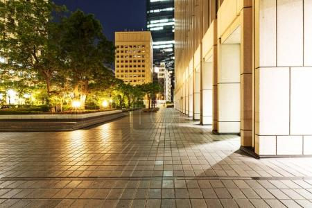 footpath outside of modern building at night