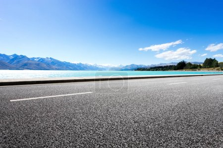 empty road with blue sea