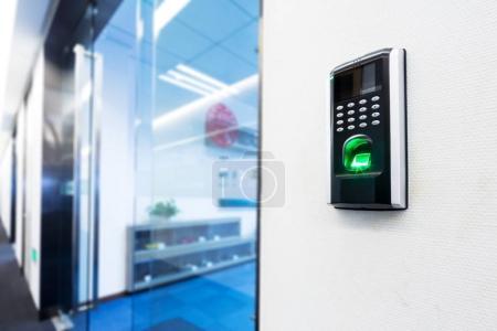 fingerprint scanner on wall