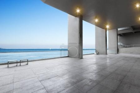 empty marble floor and blue sea in blue sky