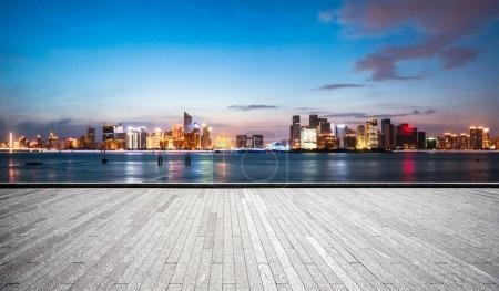 Photo for Empty brick floor and cityscape of Hangzhou in blue cloud sky - Royalty Free Image
