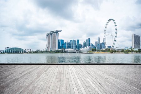 empty brick floor and cityscape of Singapore in cloud sky
