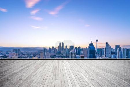 Photo for Empty brick floor and cityscape of Kuala Lumpur at dawn - Royalty Free Image