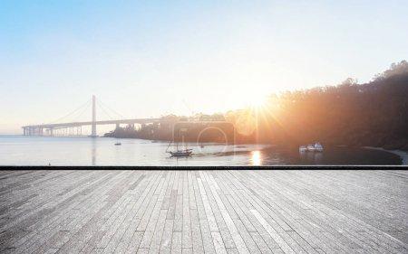 empty brick floor and Gold Gate Bridge under sunshine