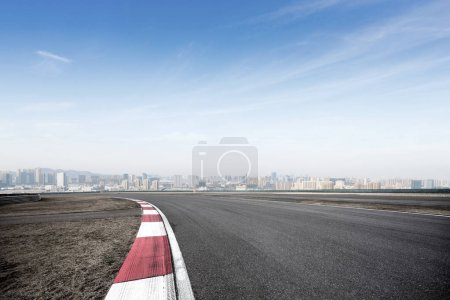 Photo for Empty asphalt road and cityscape of Shaoxing in blue foggy sky - Royalty Free Image