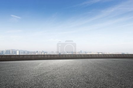 Empty asphalt road and cityscape of Shaoxing in bl...