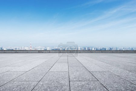 empty marble floor and cityscape of Tokyo in blue cloud sky