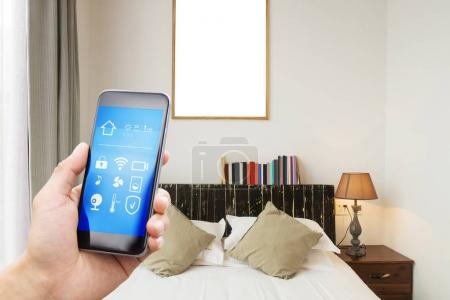 smartphone with smart home and modern bedroom