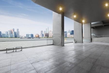 Empty marble floor and cityscape of Hangzhou Qianj...
