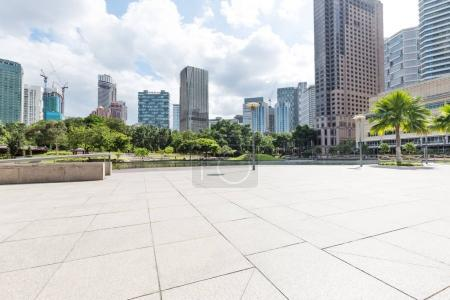 Photo for Empty marble floor and modern buildings in midtown of Kuala Lumpur in cloud sky - Royalty Free Image