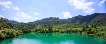 Photo for Clear and turquoise lake surrounded by mountains - Royalty Free Image