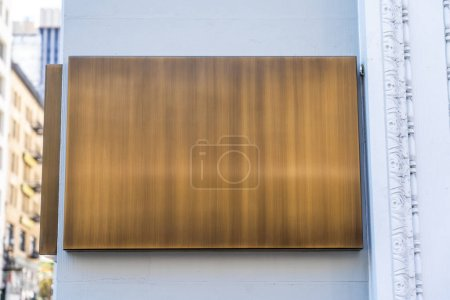 Photo for Wooden plaque on a wall in the city. - Royalty Free Image