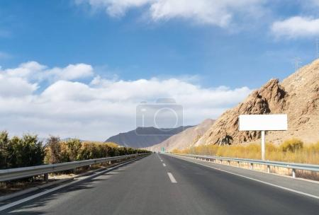 Photo for Highway landscape with blank billboard in tibet - Royalty Free Image