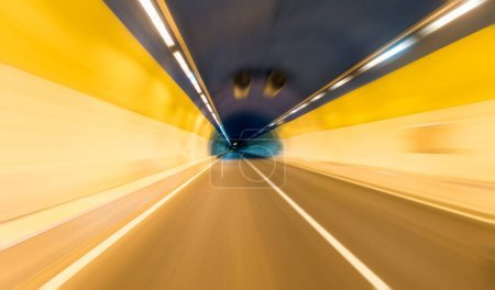 Photo for Tunnel background with car driving speed blurred motion - Royalty Free Image
