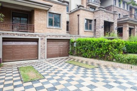 Photo for Garage doors in a modern suburban residential house - Royalty Free Image