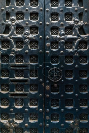 Ornate aged metal door