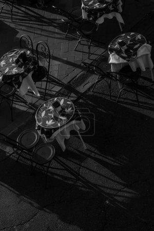 Photo for Monochrome photo of tables and chairs on outdoor patio - Royalty Free Image