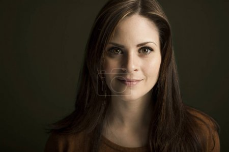 Photo for Portrait of young woman on dark background - Royalty Free Image
