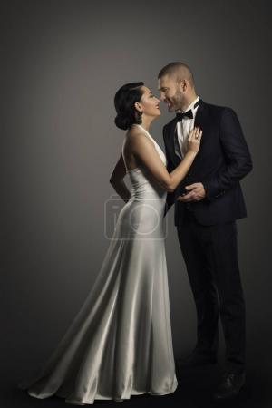 Retro Couple, Well Dressed Woman in Long Dress and Elegant Man in Black Suit