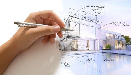 Photo pour Conception à la main d'une villa design et le bâtiment devient réel - image libre de droit