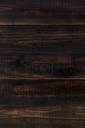 Photo pour Fond en bois brun foncé composé de planches - image libre de droit
