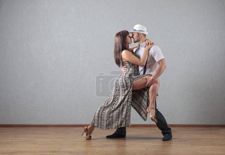 Photo for Couple dancing in studio. Guy and  girl in dance movement . Copy space . - Royalty Free Image