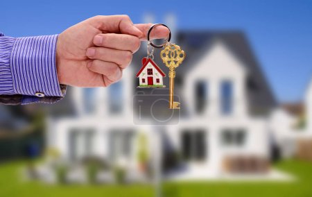 Photo for Key in hand of real estate agent as offer for your new home - Royalty Free Image