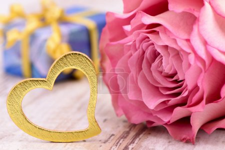 Photo for Valentines day in romance with rose and heart as symbol for love - Royalty Free Image