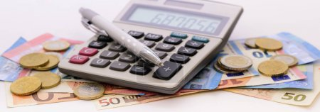Photo for Many banknotes of European currency with calculator and coins - Royalty Free Image