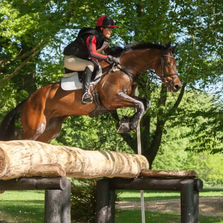 Photo for HOUGHTON, NORFOLK/ENGLAND - May 27th 2017: Houghton International Horse Trials 2017 Loretta Joynson riding PSH Convivial. Including cross country, eventing, show jumping and dressage at the top level - Royalty Free Image