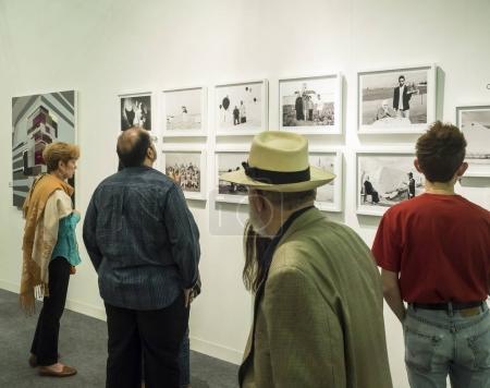 Visitors looking at artworks