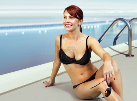 happy woman in bathing suit relaxing