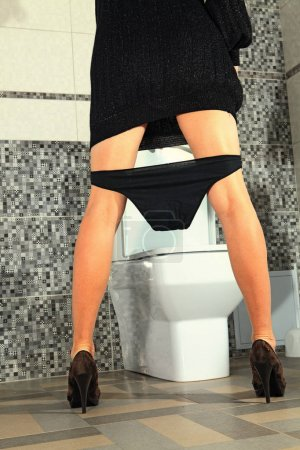 Part of the woman who stays near toilet bowl...