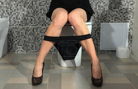 Part of the woman who sits on a toilet bowl...