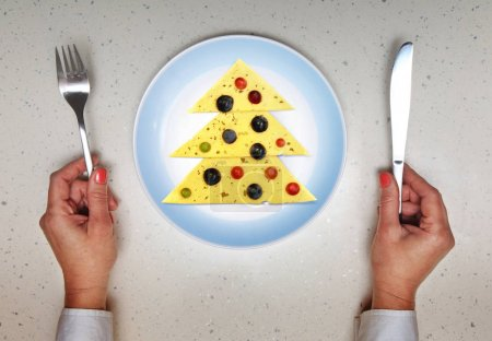 Photo for Extraordinary festive dish served on Christmas, hands with kitchen flatware - Royalty Free Image