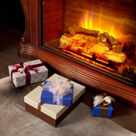 Christmas gifts boxes near fireplace