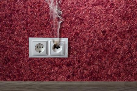 burned standard electrical outlet