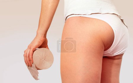 toilet roll in hand of woman