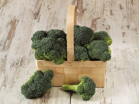 Photo for Fresh Brocoli on the wooden background - Royalty Free Image