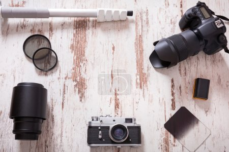 Photo for Travel photography background with cameras, monopod, filters and bateries - Royalty Free Image