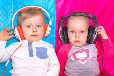 Twins listening to the music