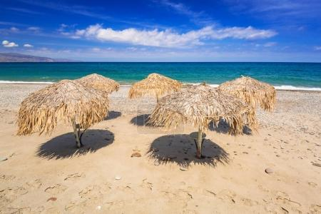 Tropical parasols at Maleme beach on Crete