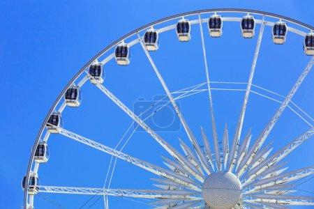 Ferris wheel over blue sky in Gdansk