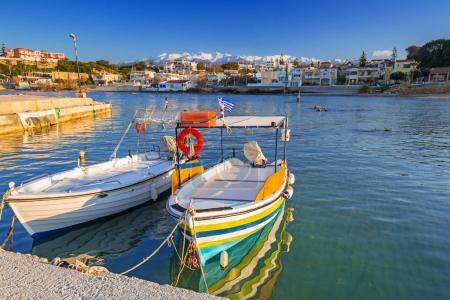 Fishing boats on the coastline of Kato Galatas town on Crete