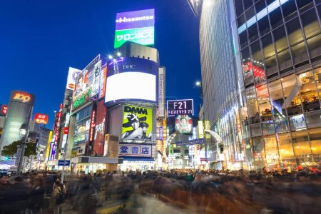 Photo for TOKYO, JAPAN - NOVEMBER 12, 2016. Shibuya scramble crossing in Tokyo at night, Japan. Shibuya Crossing is one of the busiest crosswalks in the world. - Royalty Free Image