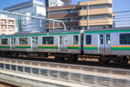 Train in motion on the railway of Tokyo
