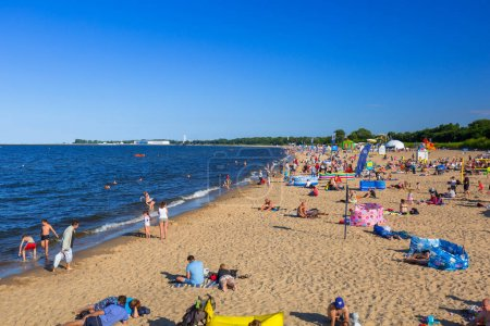 People on the sunny beach of Baltic Sea in Gdansk