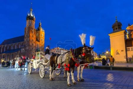 Horse carriages at the Main Square in Krakow