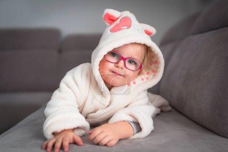 Little toddler girl portrait in the bathrope