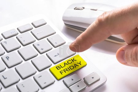 Finger pressing computer button with Black Friday sign